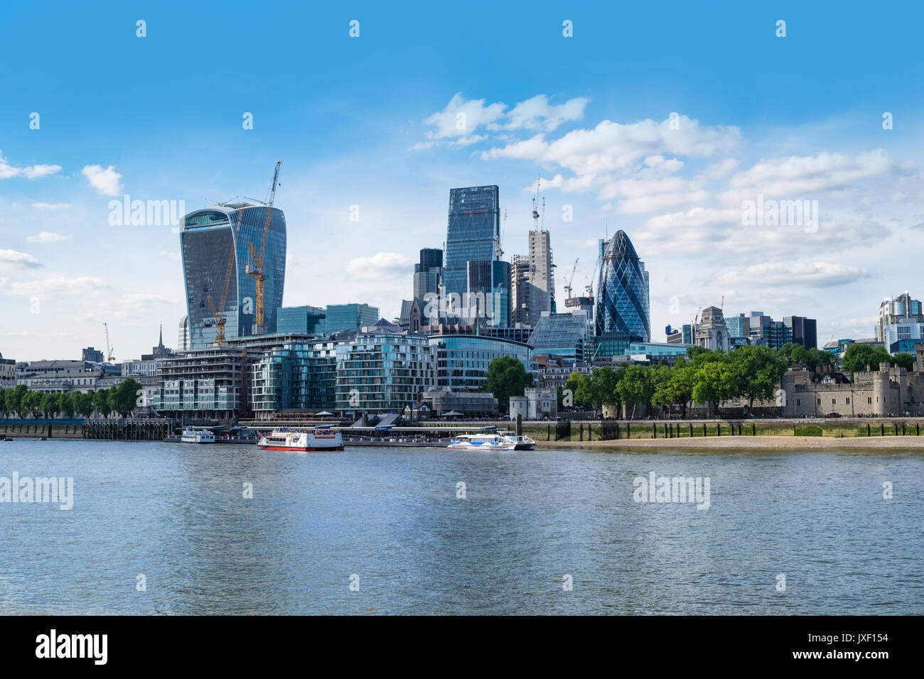 London, UK 21st May 2017. City of London financial district seen across Thames, from Tower Bridge. Stock Photo