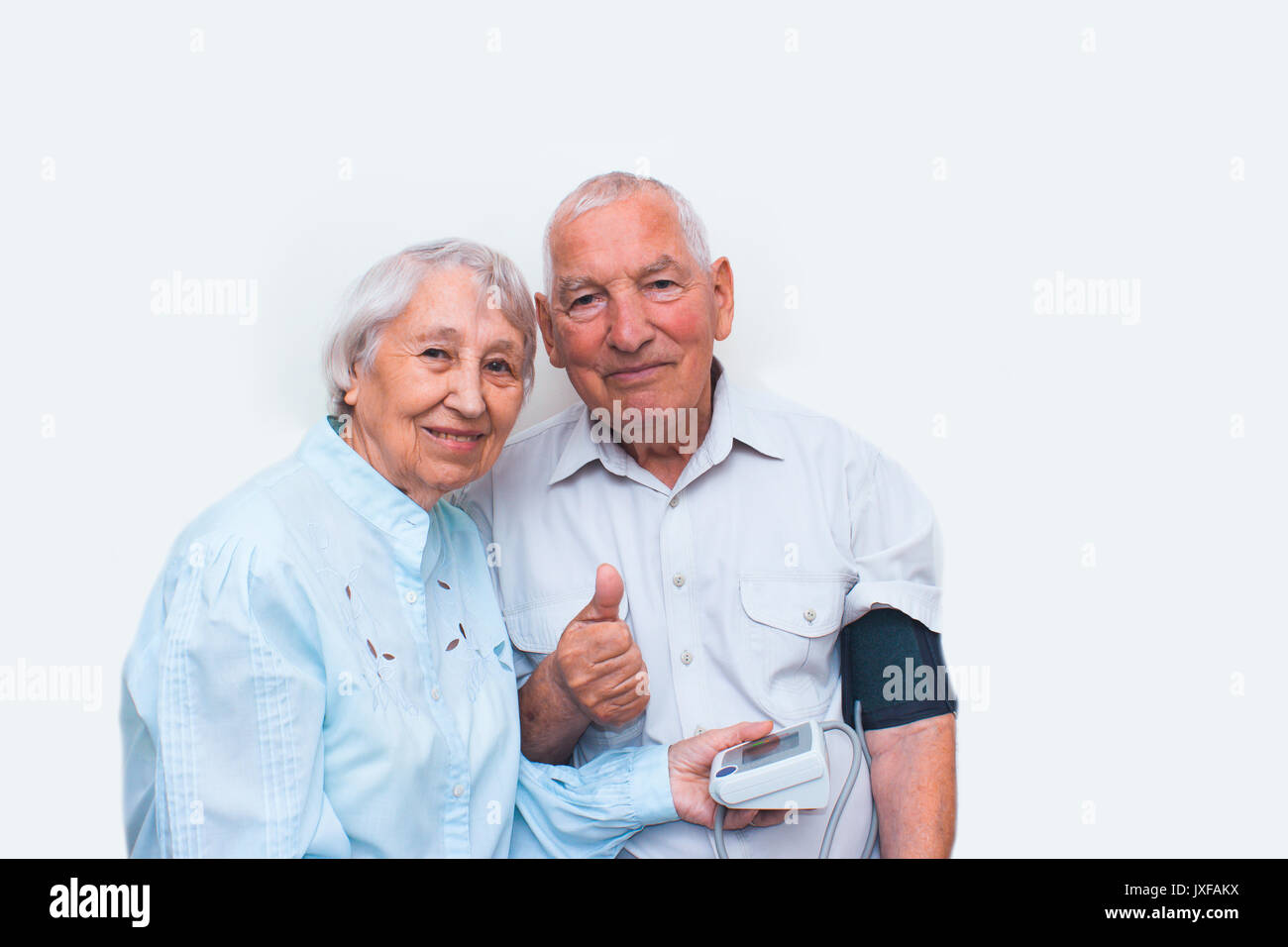 Apparatus measuring the pressure in the hands of an elderly woman. - Stock Image
