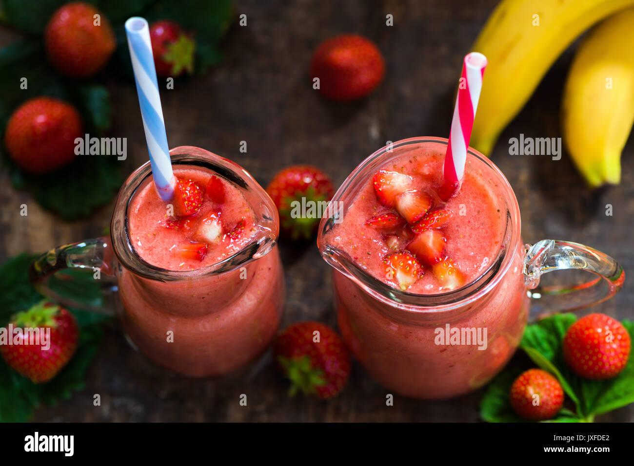 Fresh strawberry and banana smoothie - high angle view - Stock Image