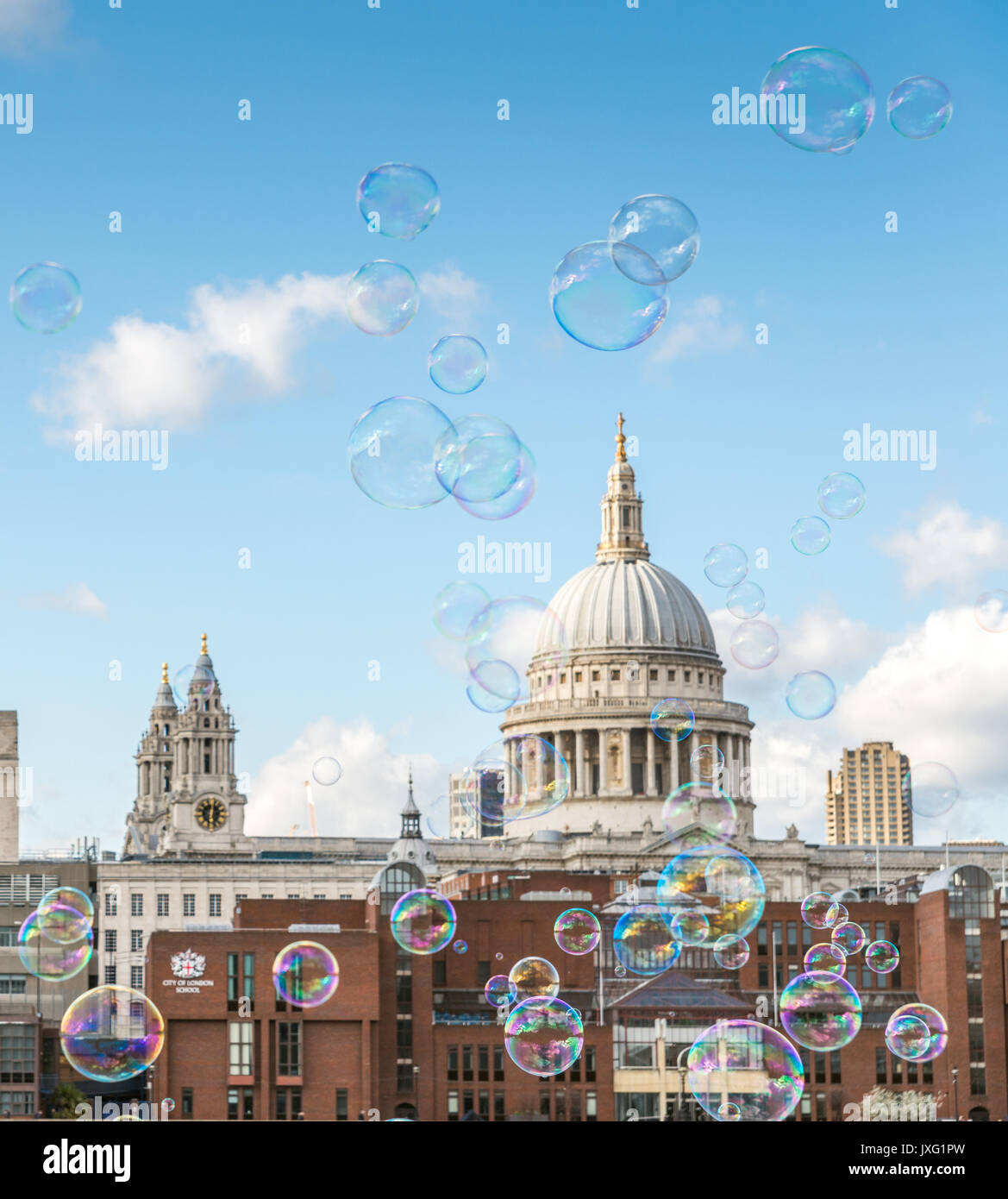 Bubbles and St. Paul's cathedral on a sunny day, London - Stock Image