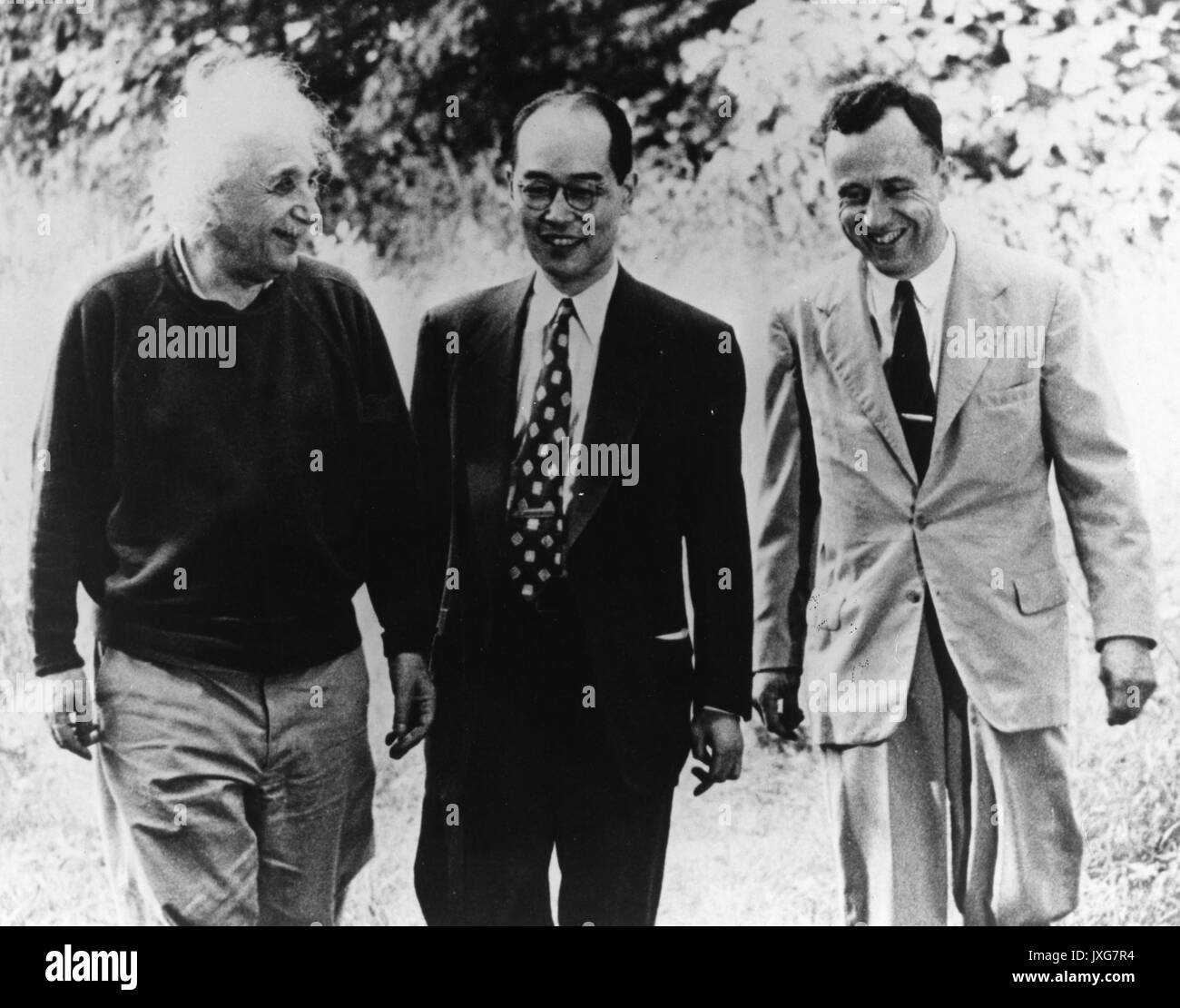 John Archibald Wheeler, Albert Einstein, Hideki Yukawa, Einstein, Yukawa, and Wheeler are conversing together at Princeton, 1954. Stock Photo