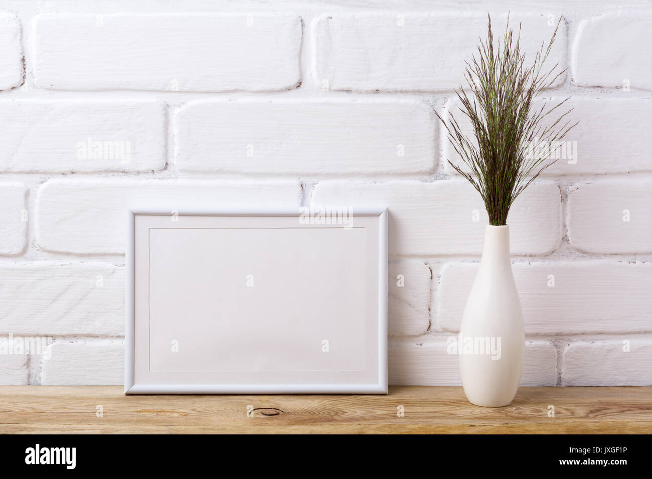 White Landscape Frame Mockup With Dark Meadow Grass In Elegant Vase Stock Photo Alamy