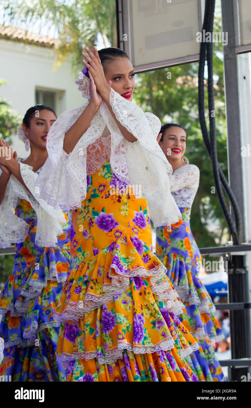 Flamenco dancers performing on stage in traditional costumes - Stock Image