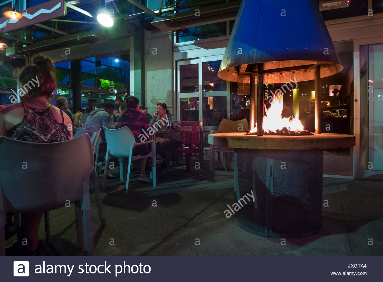 Patrons Dining Outside Next To A Fire At Cactus Alki Beach Stock