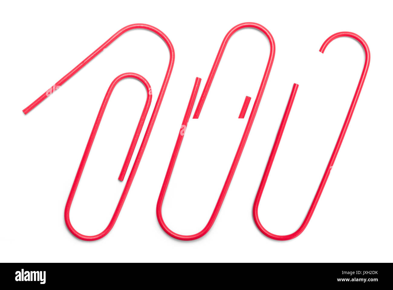 Three Red Paper Clips Variations Isolated on White Background. - Stock Image