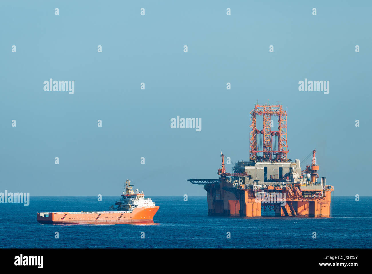Supply vessel Normand Aurora next to West Phoenix oil rig, oil extraction, North Sea Stock Photo