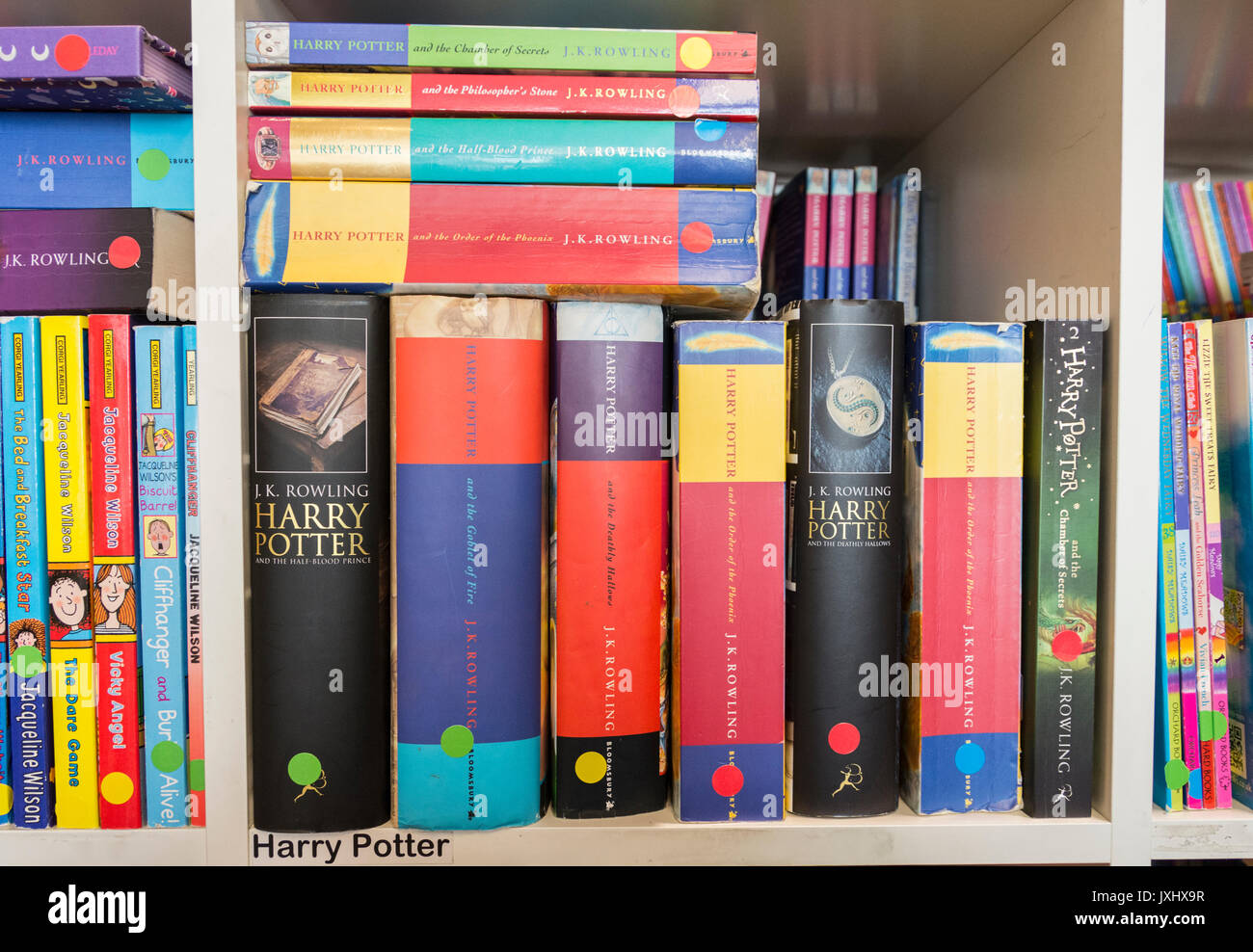 Some Of JK Rowlings Harry Potter Titles Sitting On A Bookshelf In Second Hand Bookshop