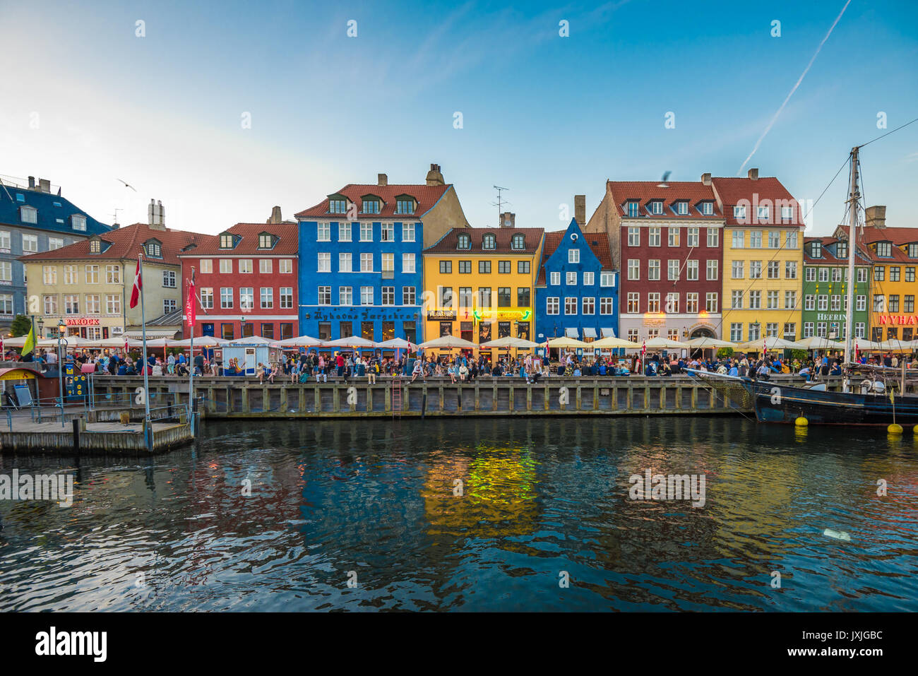 Nyhavn district is one of the most famous landmarks in Copenhagen, Denmark - Stock Image