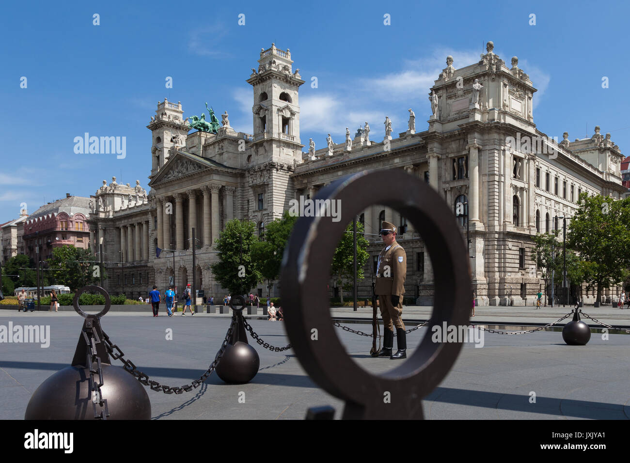 Ministry of Agriculture building, Museum of Ethnography, behind Parliament building, Budapest Hungary shot from parliament side with a guard on duty. - Stock Image