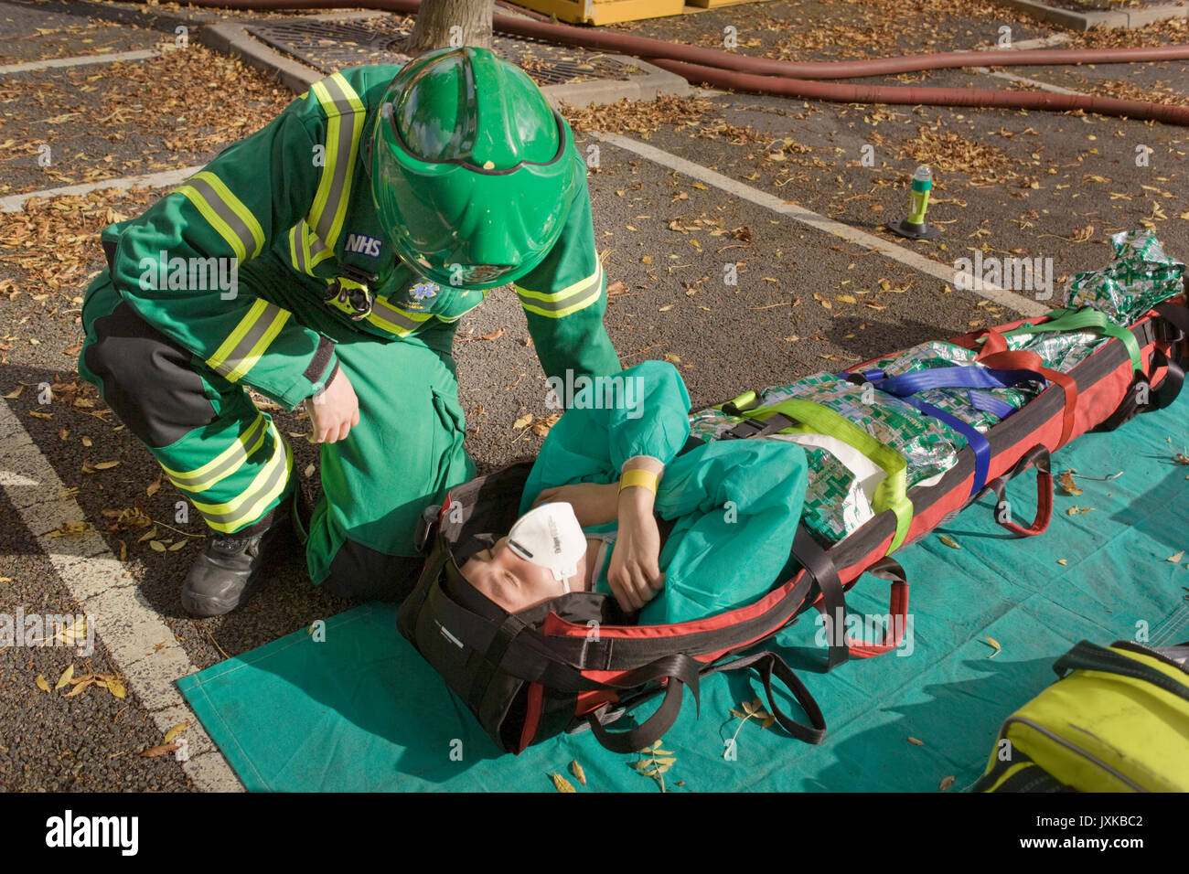 Emergency response paramedic questions simulated casualty in simulated chemical contamination incident - Stock Image