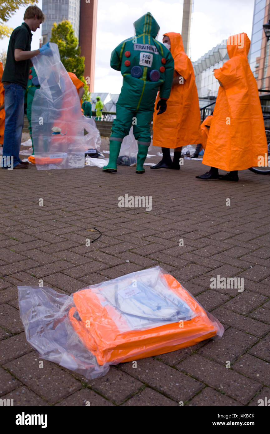A pre-packed orange coverall thrown into the 'hot' or contaminated area to be used by students changing into the brightly coloured clothing after bein - Stock Image