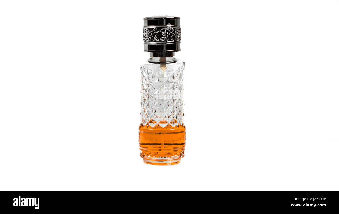 Orange Colour Perfume Bottle diamond crystal pattern - Stock Image