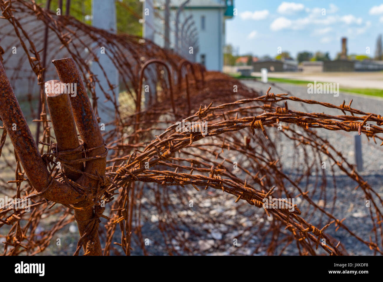 Barbed wire fence and watchtower at Sachsenhausen concentration camp memorial site - Stock Image