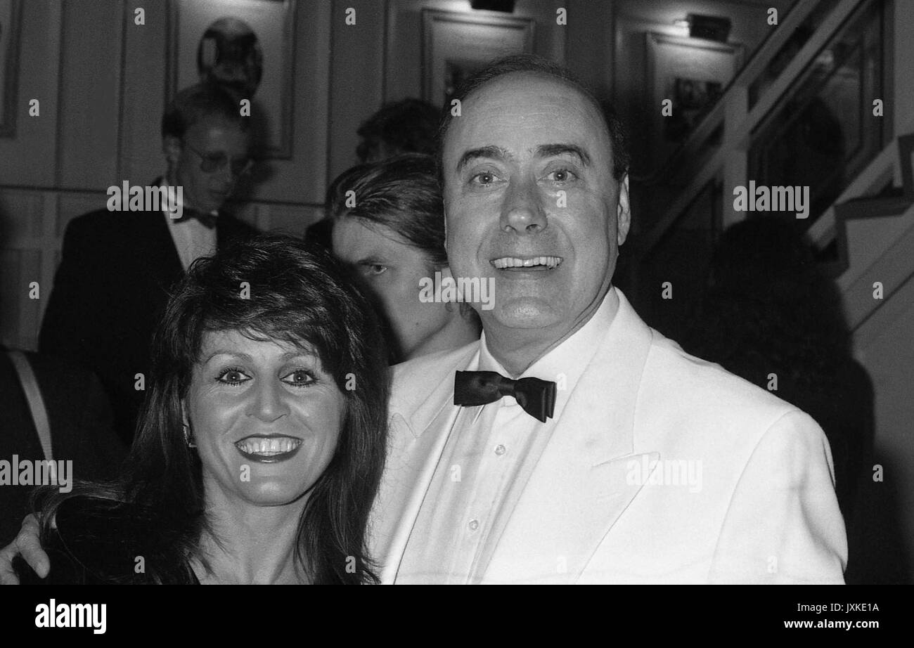 Victor Spinetti, Welsh writer, actor and raconteur, attends the British Videogram Awards with an unidentified female in London, England on October 18, 1990. - Stock Image