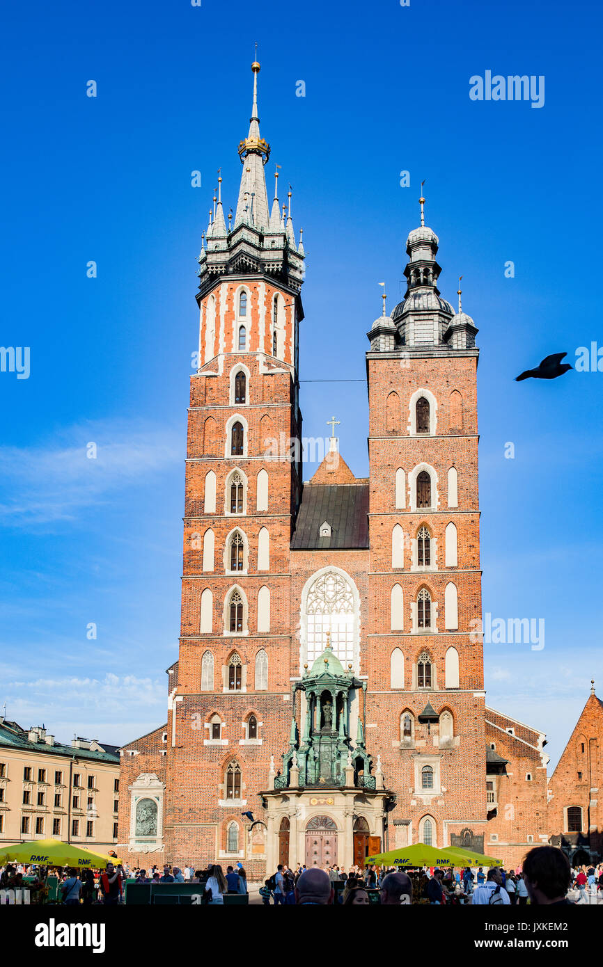 St. Mary's Basilica in Cracow (Krakow)  in Main Market Square. Poland. - Stock Image