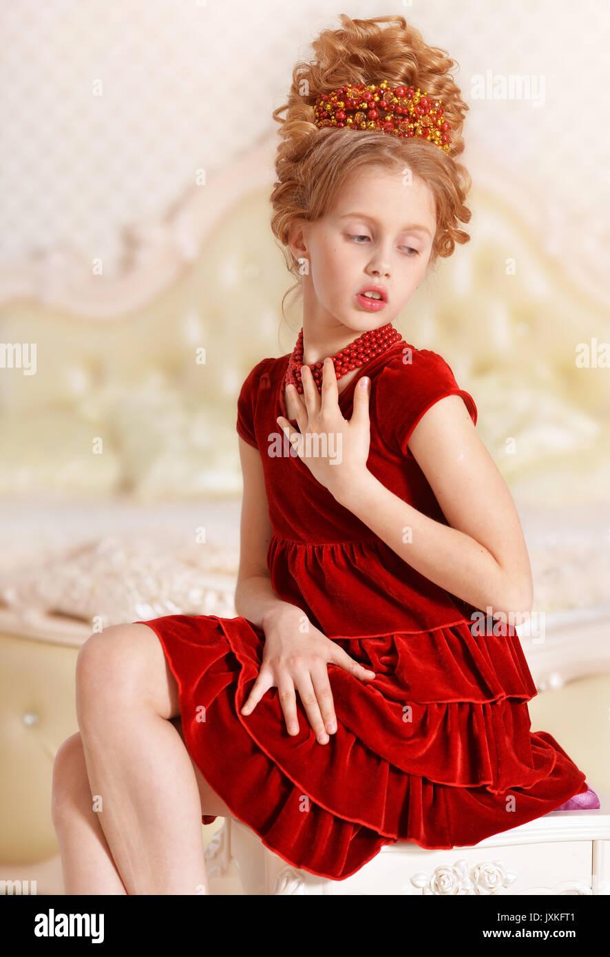 08e6ae00e40d little girl in red velvet dress Stock Photo: 154093521 - Alamy