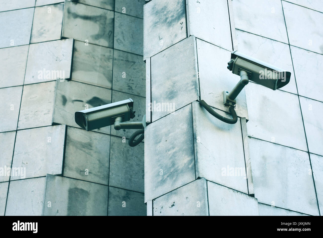Big brother concept with two security cameras on the wall - Stock Image