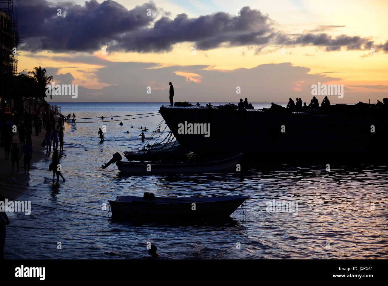 TANZANIA Zanzibar, Stone town, evening at sea, tanzanian navy ship / TANSANIA Insel Sansibar, Stonetown, abends am Meer, Schiff der tansanischen Marine - Stock Image