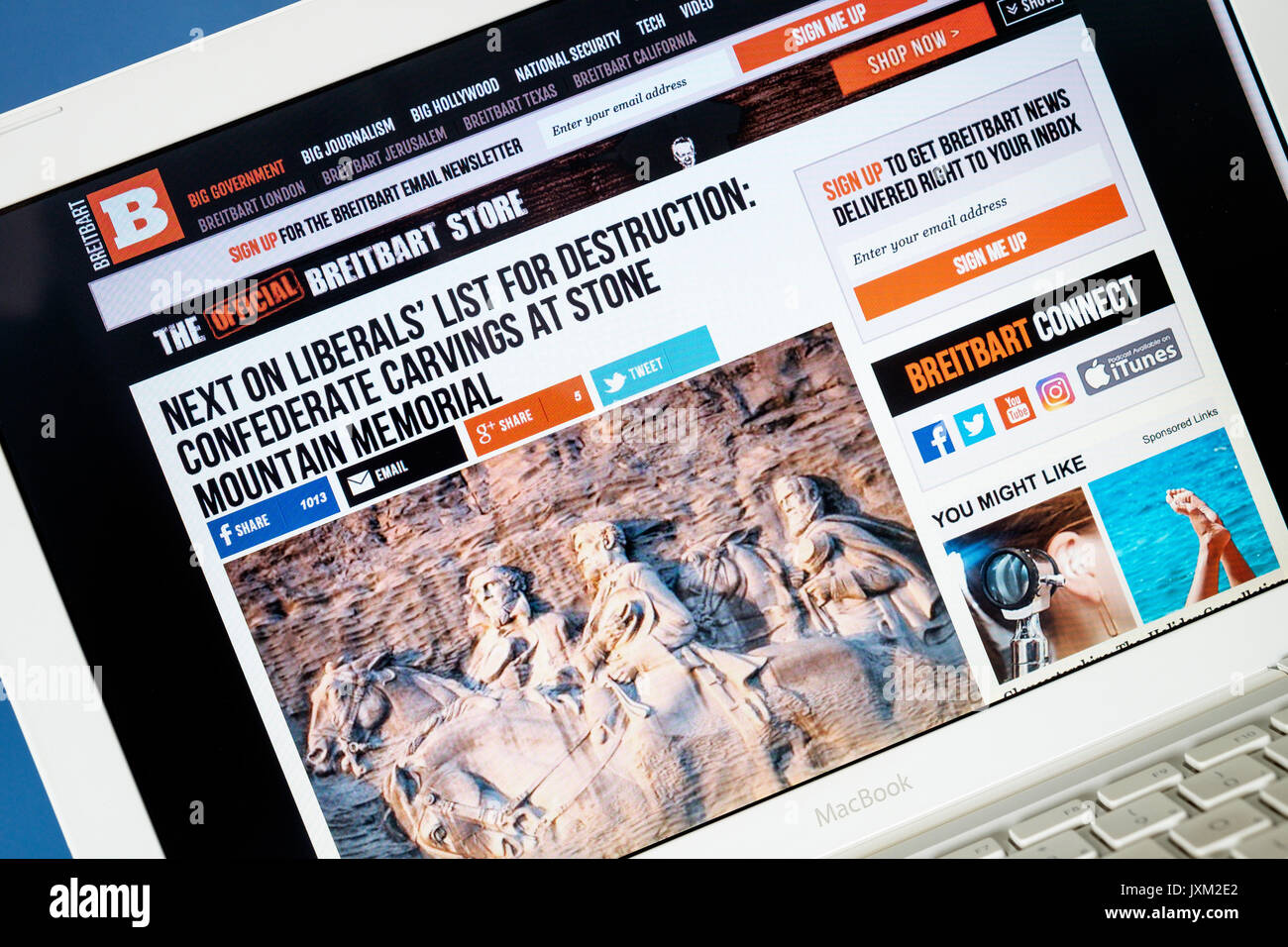 Computer monitor screen is pictured showing the far right, alt-right website Breitbart News a few days after the alt-right protest in Charlottesville - Stock Image