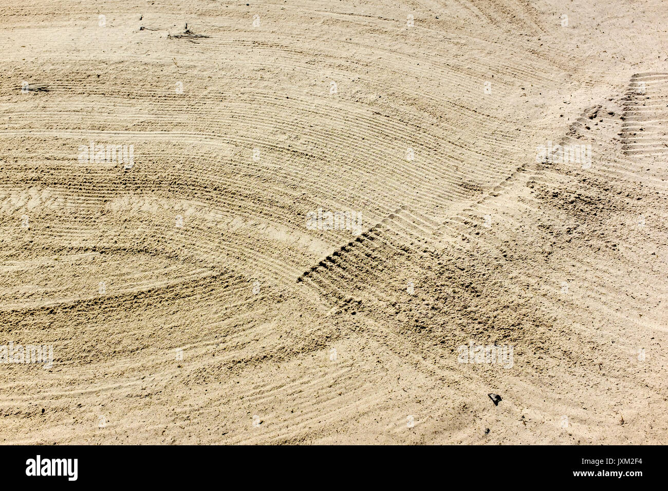 Finely raked sand in a bunker on a gold course - Stock Image
