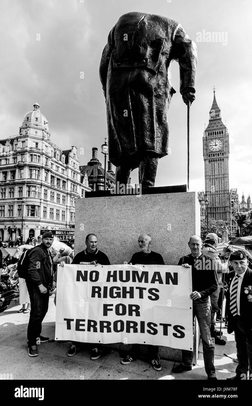 British Army Veterans Standing Under The Statue Of Winston Churchill Hold A Banner Demanding 'No Human Rights For Terrorists' , London, UK - Stock Image