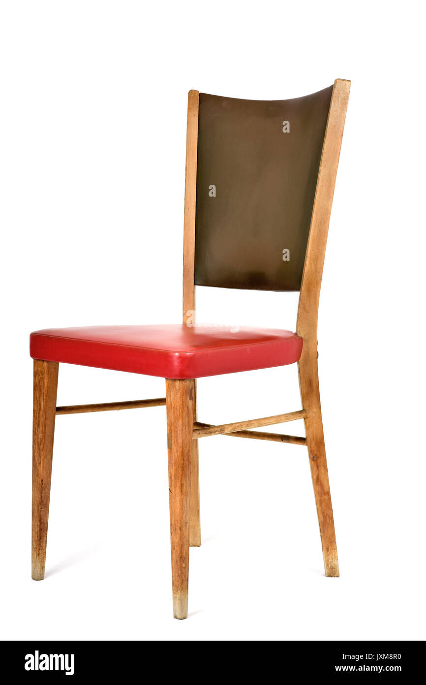 an old chair upholstered in leatherette of different colors, red and green, on a white background - Stock Image