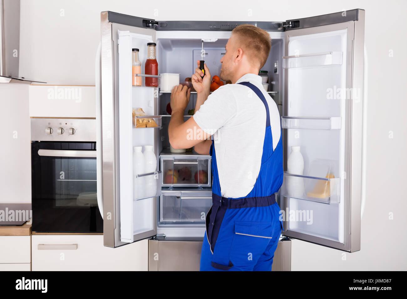 Male Technician Repairing Broken Refrigerator Appliance With Stock Photo Alamy