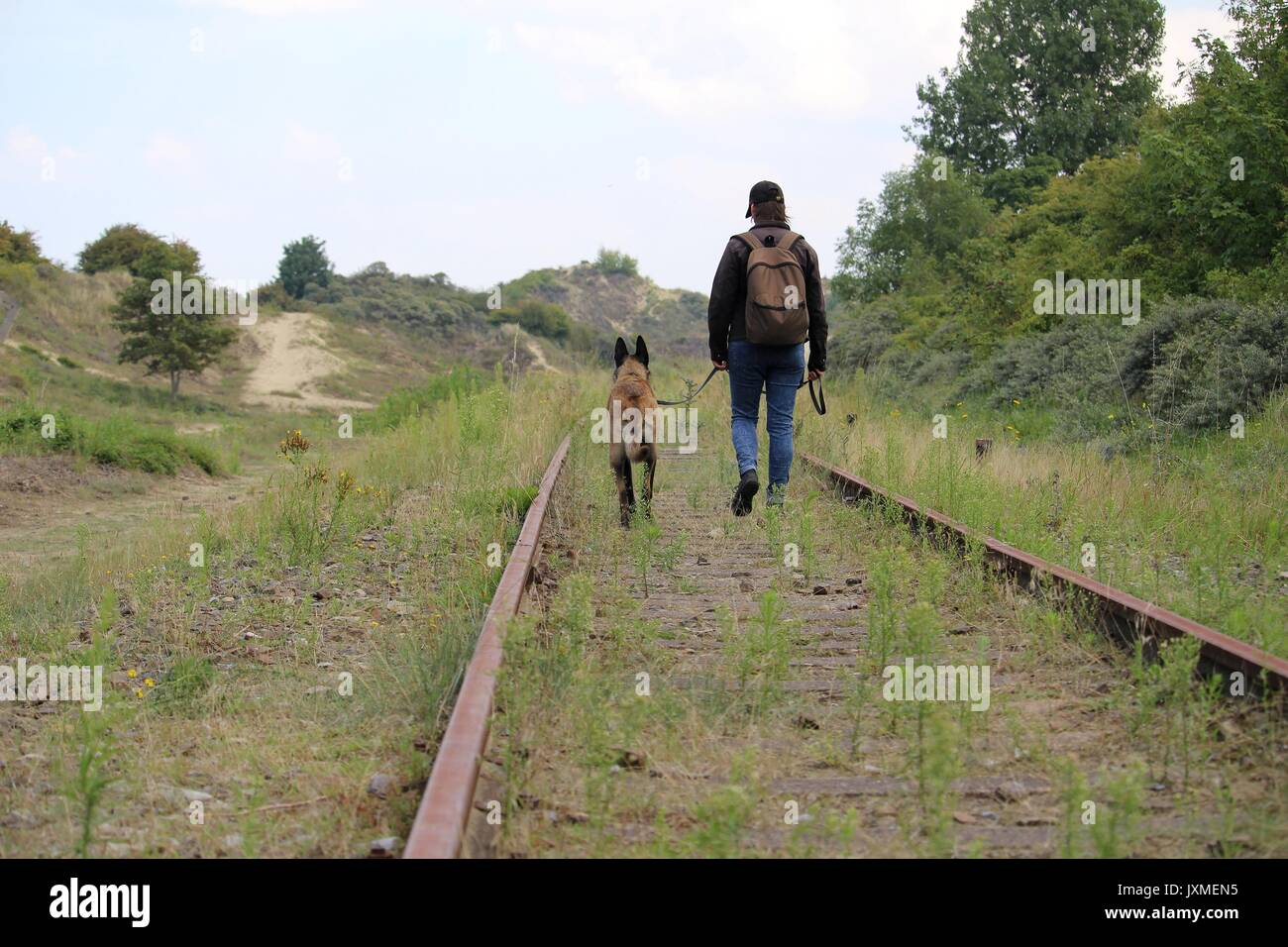 Travel between master and dog along the old rails - Stock Image