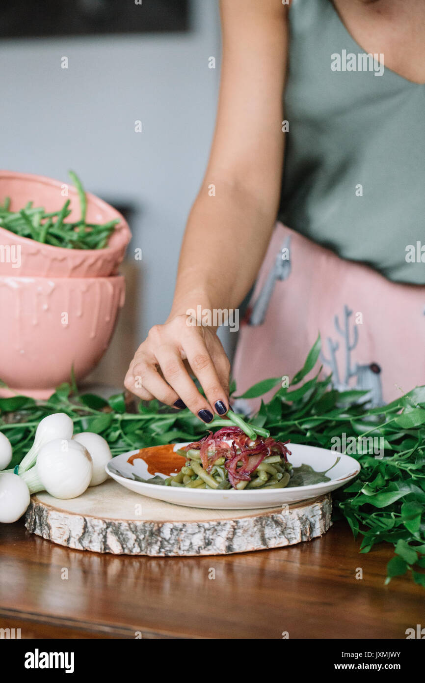 Woman preparing vegetarian dish Stock Photo