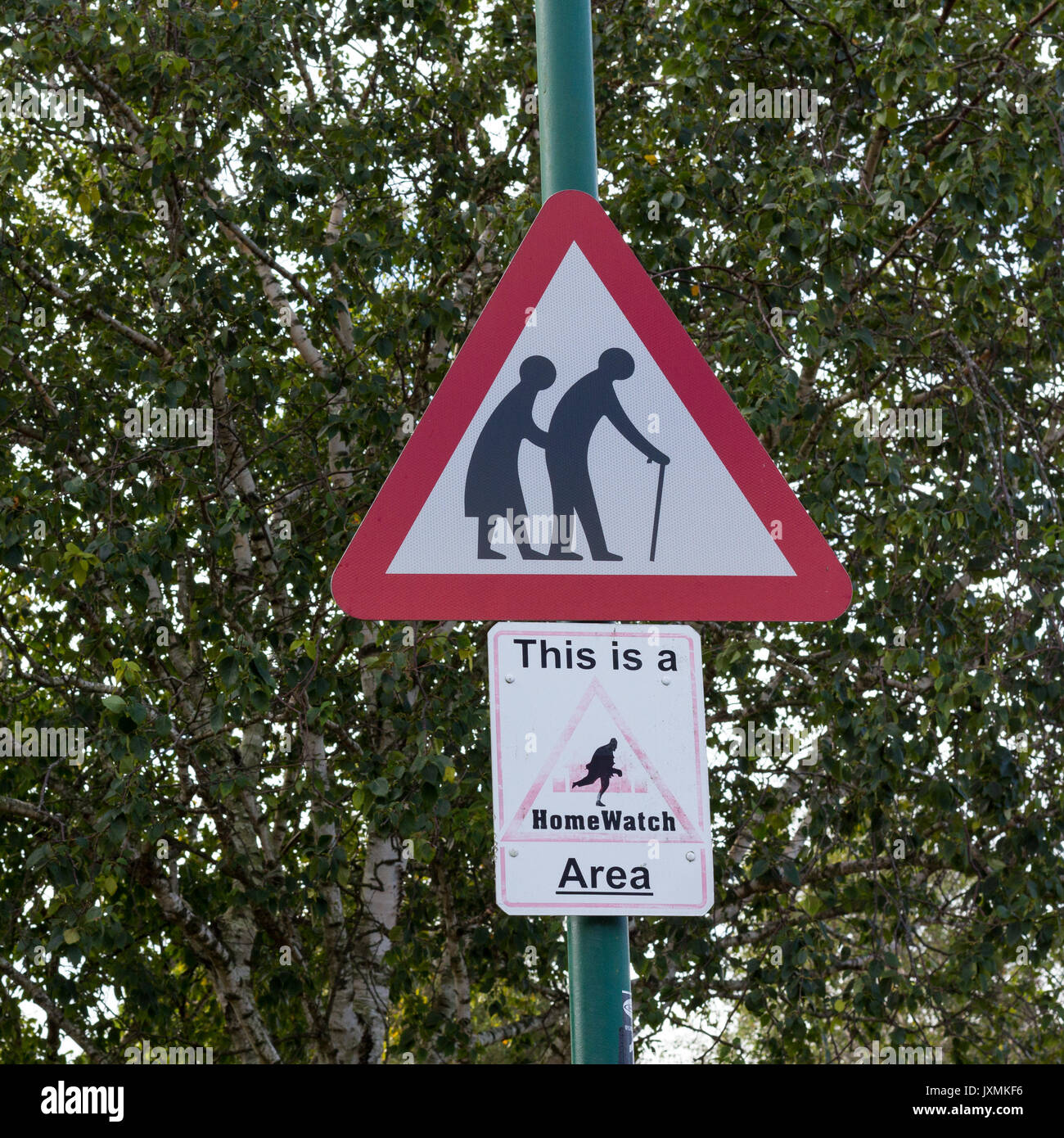 Old people warning red triangular road sign, This is a HomeWatch Area sign, Dorset, UK Stock Photo