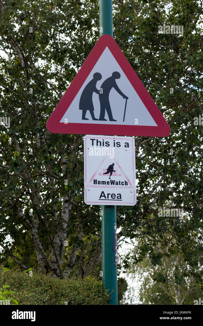 Old people warning red triangular road sign, This is a HomeWatch Area sign, Dorset, UK - Stock Image