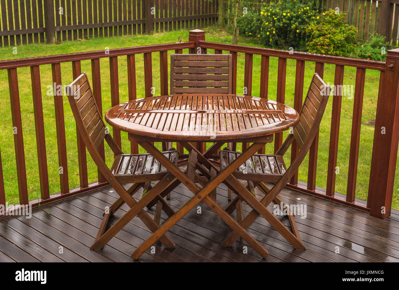 Rain Soaked Garden Table Chairs On A Wet Day In The Uk When Summer