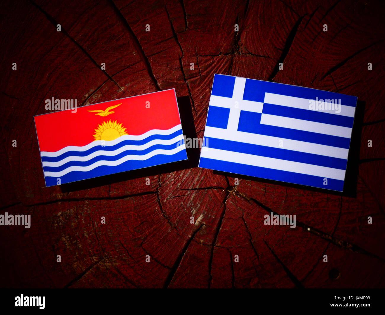 Kiribati flag with Greek flag on a tree stump isolated - Stock Image