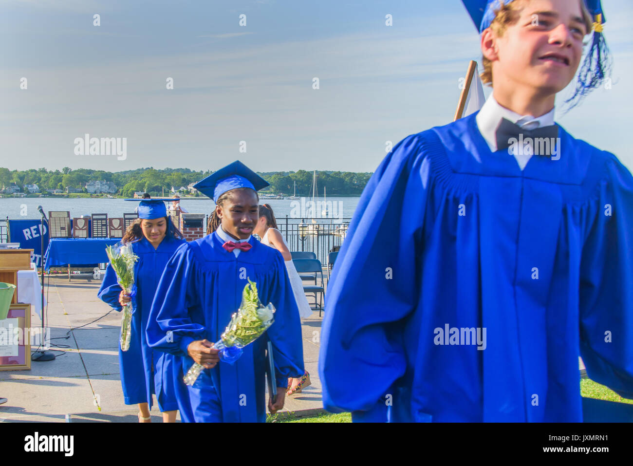 Students in graduation gowns, at graduation ceremony - Stock Image