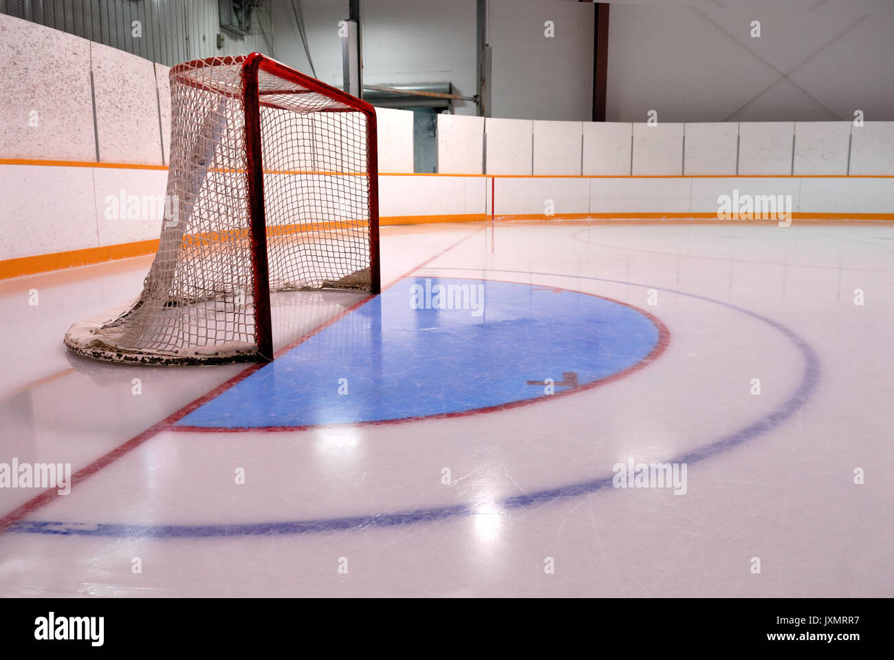 An empty  Hockey or Ringette Net and crease in the Rink with freshly cleaned ice. - Stock Image