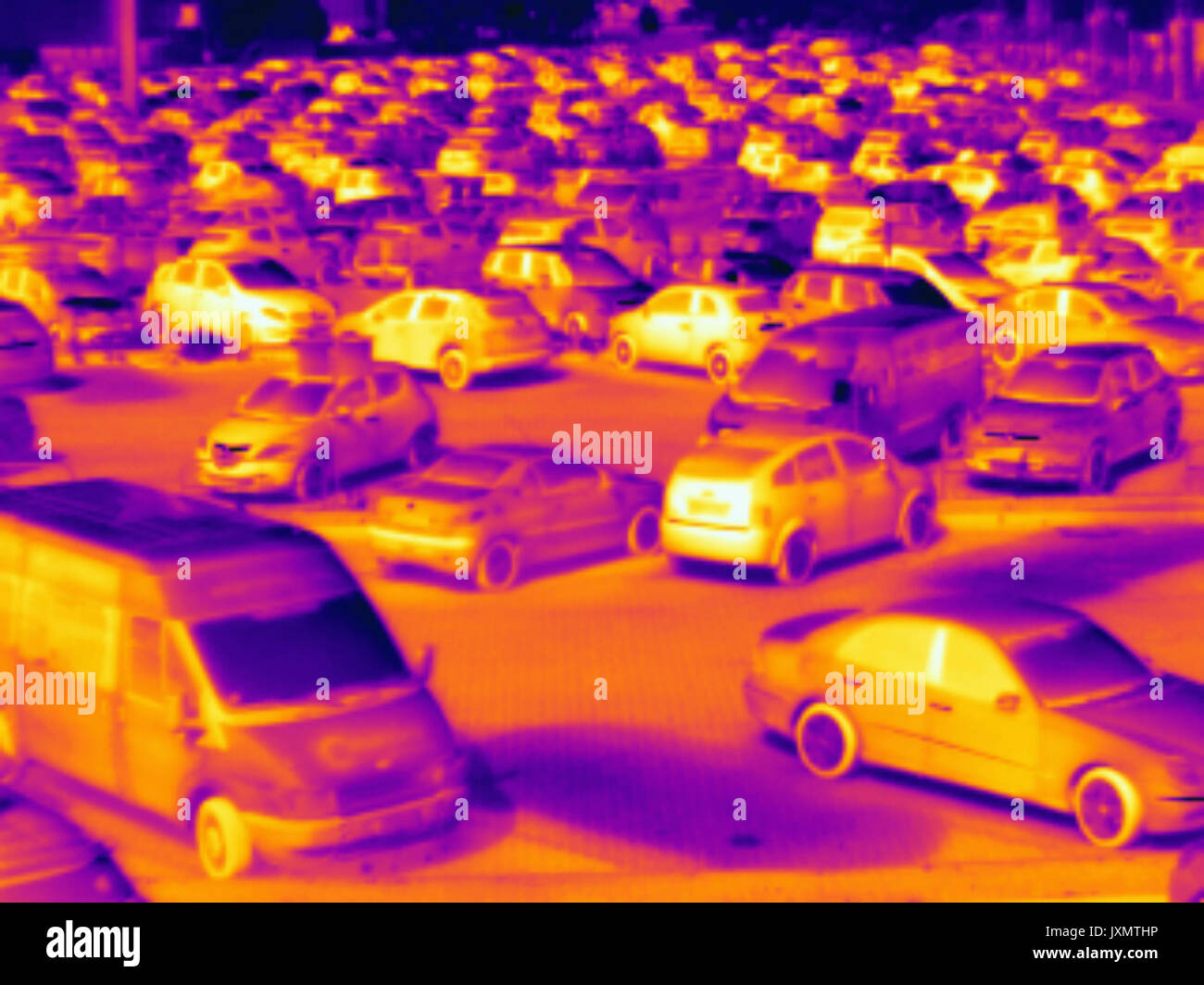 Thermal image of cars in car park - Stock Image