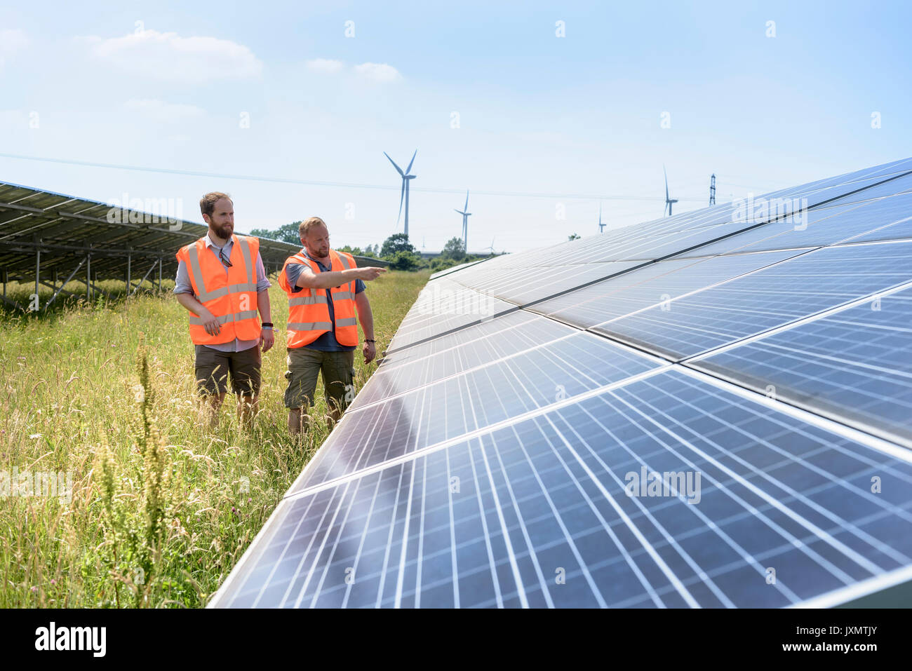 Local community members discussing their solar farm - Stock Image