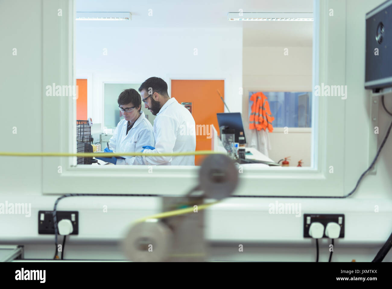 Scientist working in electrical cable laboratory - Stock Image