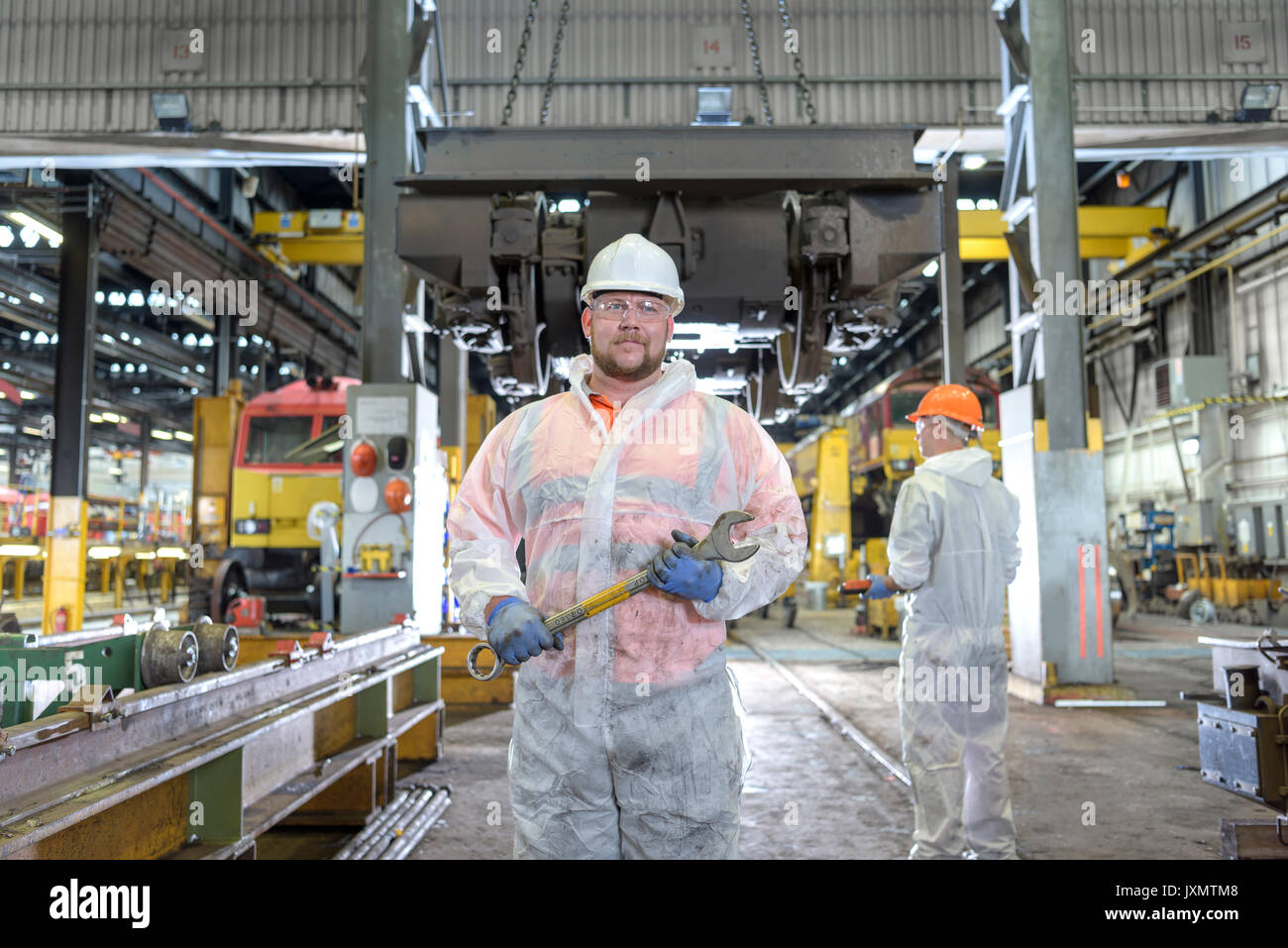 Portrait of locomotive engineer in train works - Stock Image