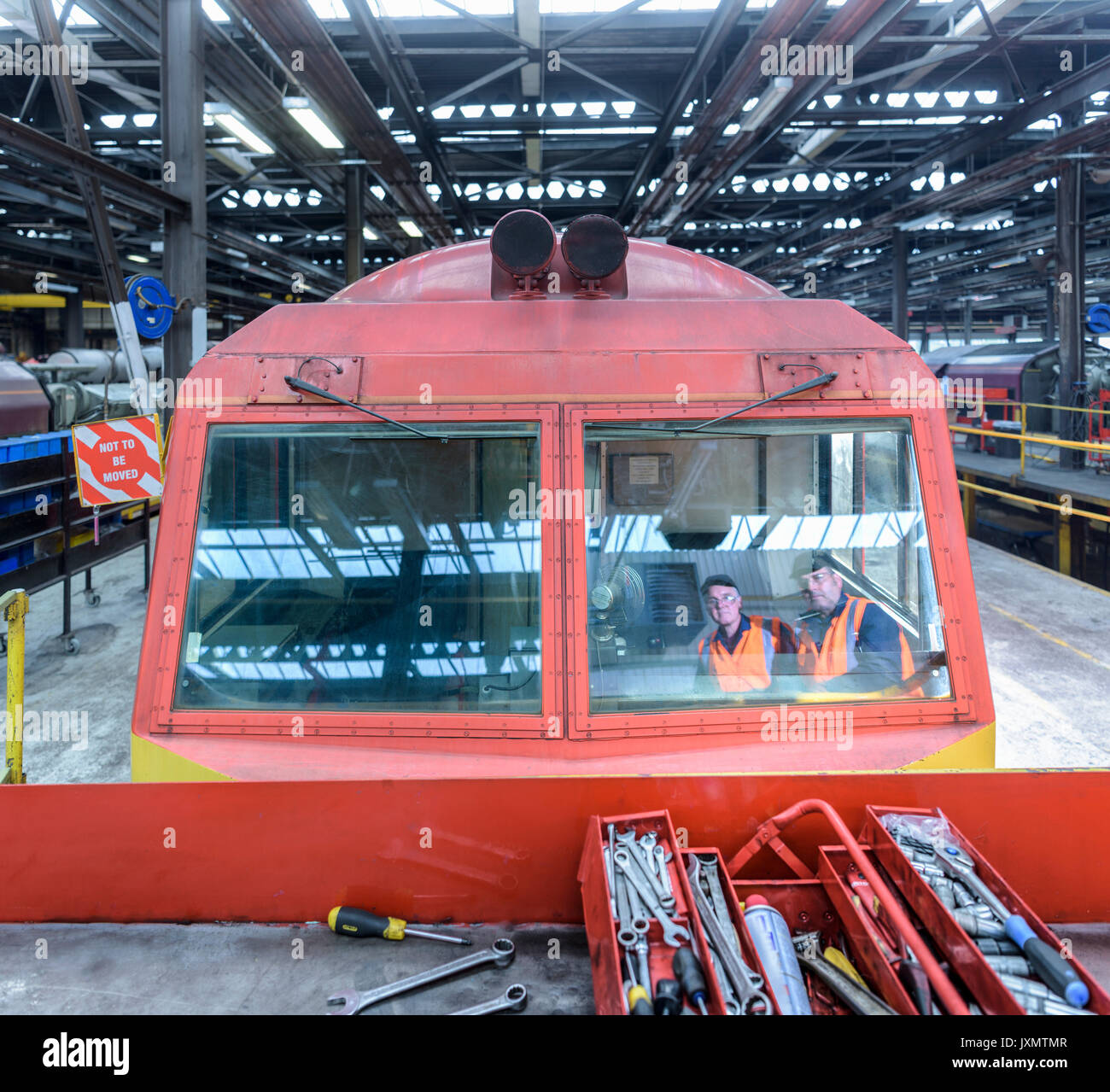 Reflection of locomotive engineers in train works - Stock Image