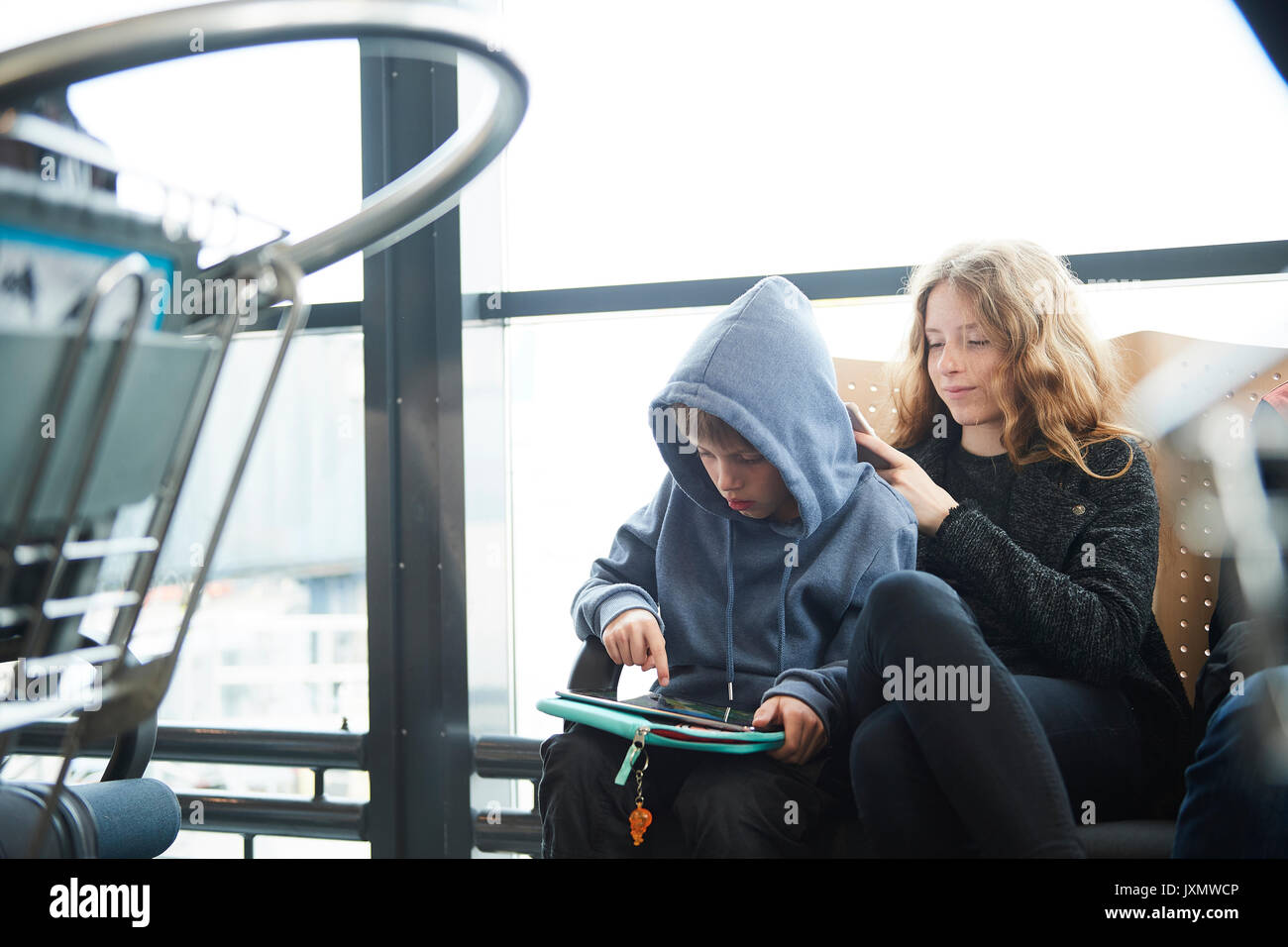 Siblings at airport on way to holiday, Copenhagen, Denmark - Stock Image