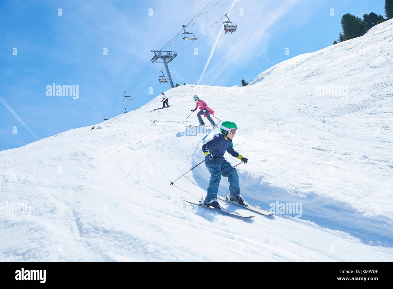 Family on skiing holiday, Hintertux, Tirol, Austria - Stock Image