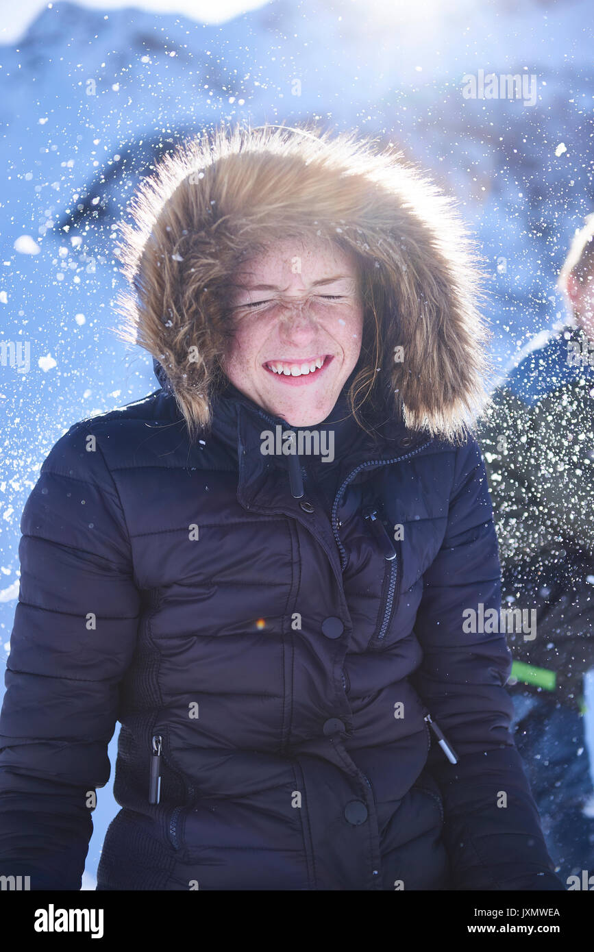 Siblings having snow ball fight, Hintertux, Tirol, Austria - Stock Image