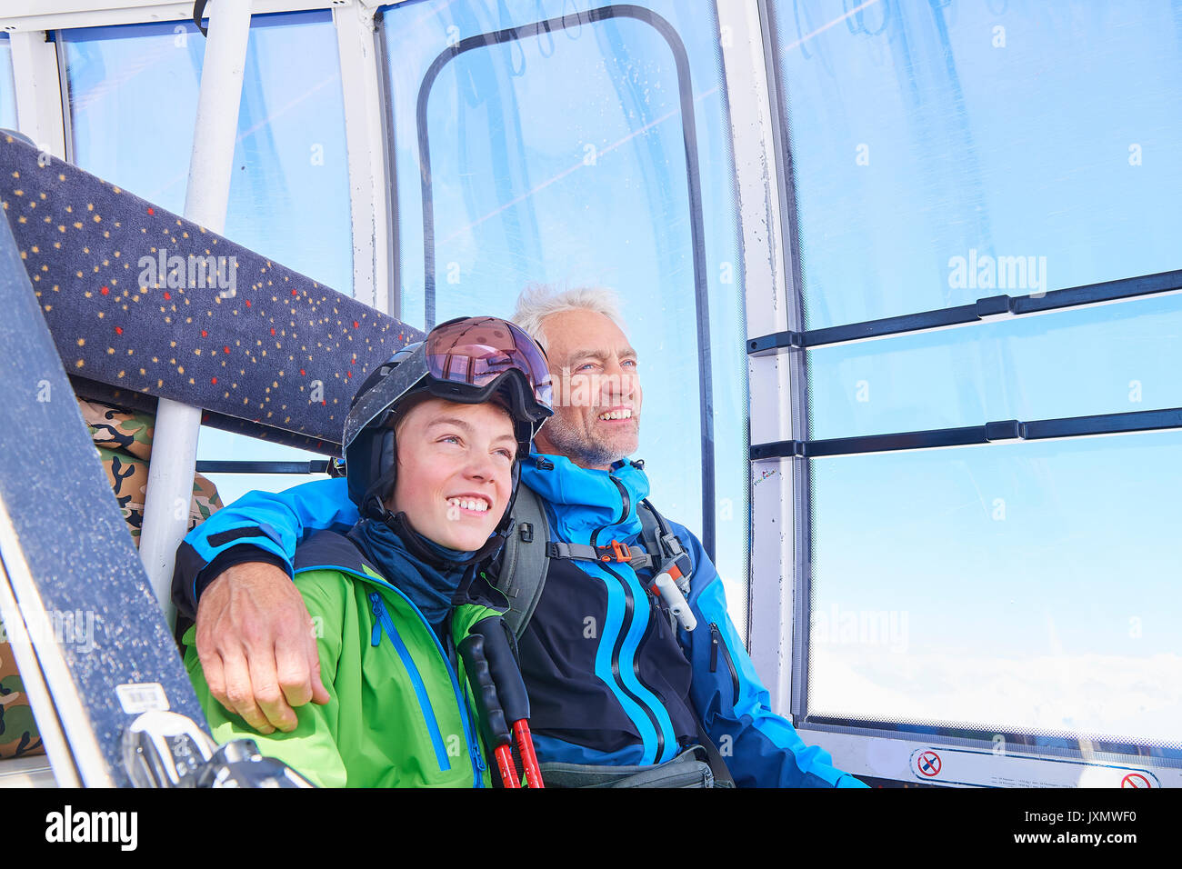 Father and son in cable car, Hintertux, Tirol, Austria - Stock Image