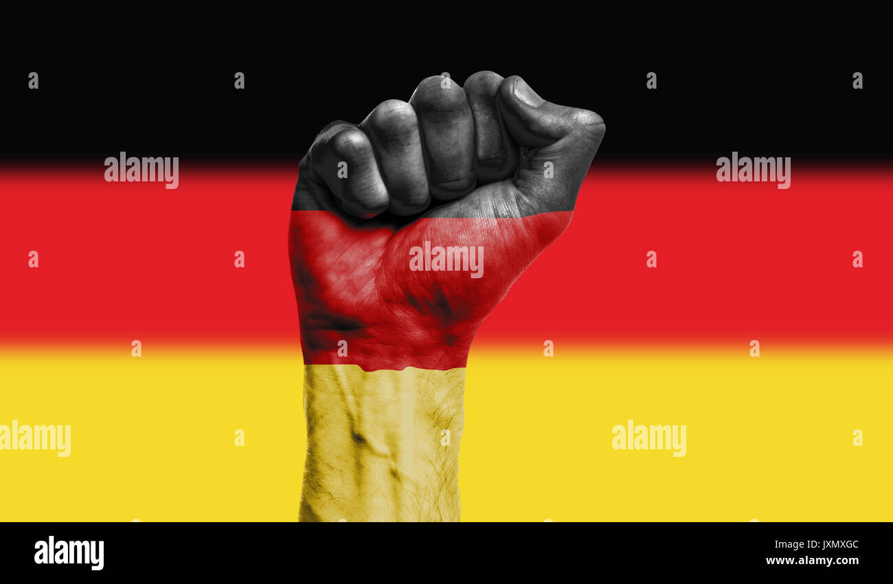 Germany flag painted on a clenched fist. Strength, Power, Protest concept Stock Photo