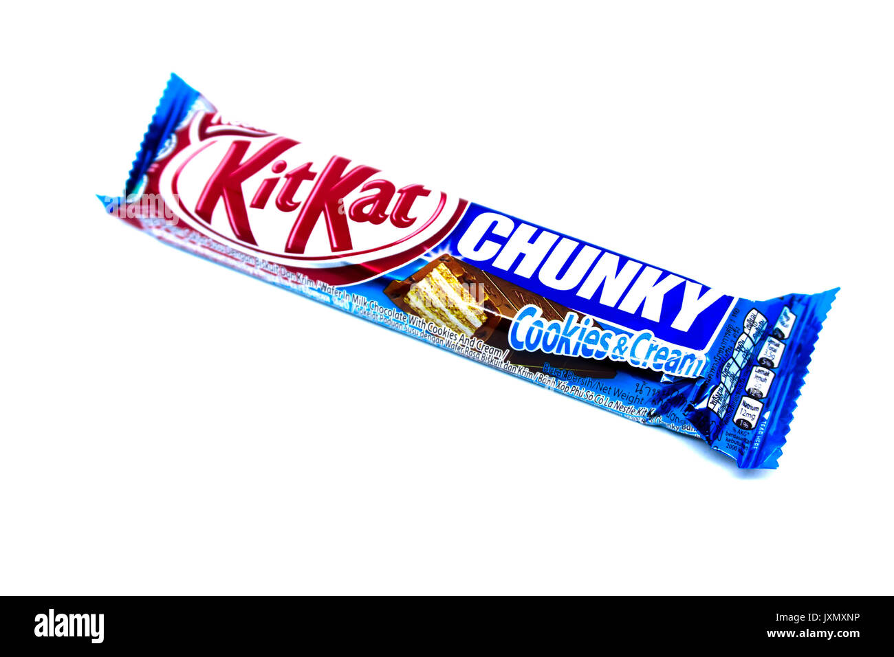 Kota Kinabalu, Malaysia - August 16, 2017: Kit Kat Chunky Cookies and Cream flavored isolated on white background. Kit Kat bars are produced by Nestle - Stock Image