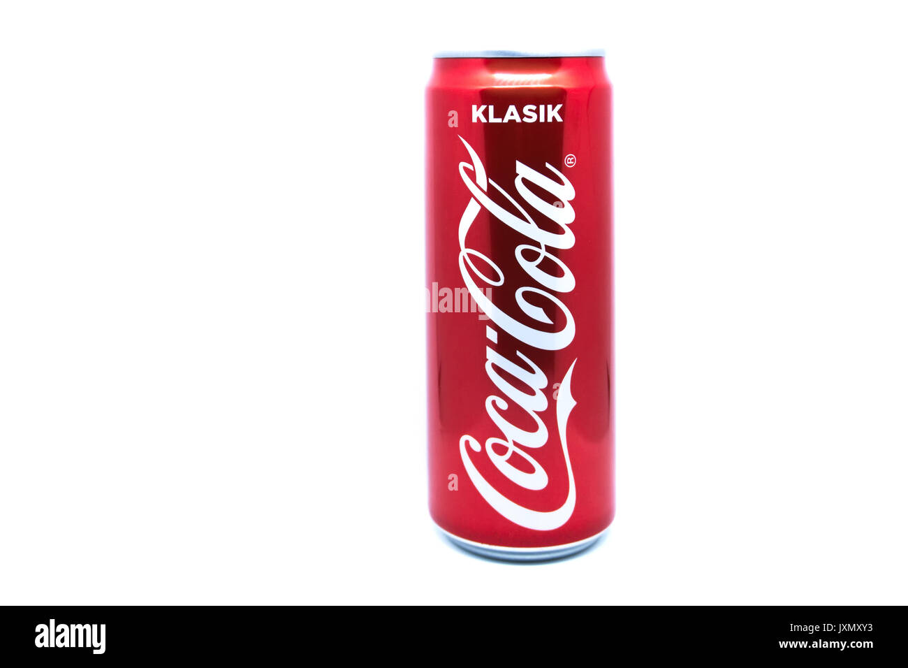 Kota Kinabalu, Malaysia - August 16, 2017: A can of Coca Cola on white background. Coca-Cola is a carbonated soft drink sold in stores, restaurants, a - Stock Image