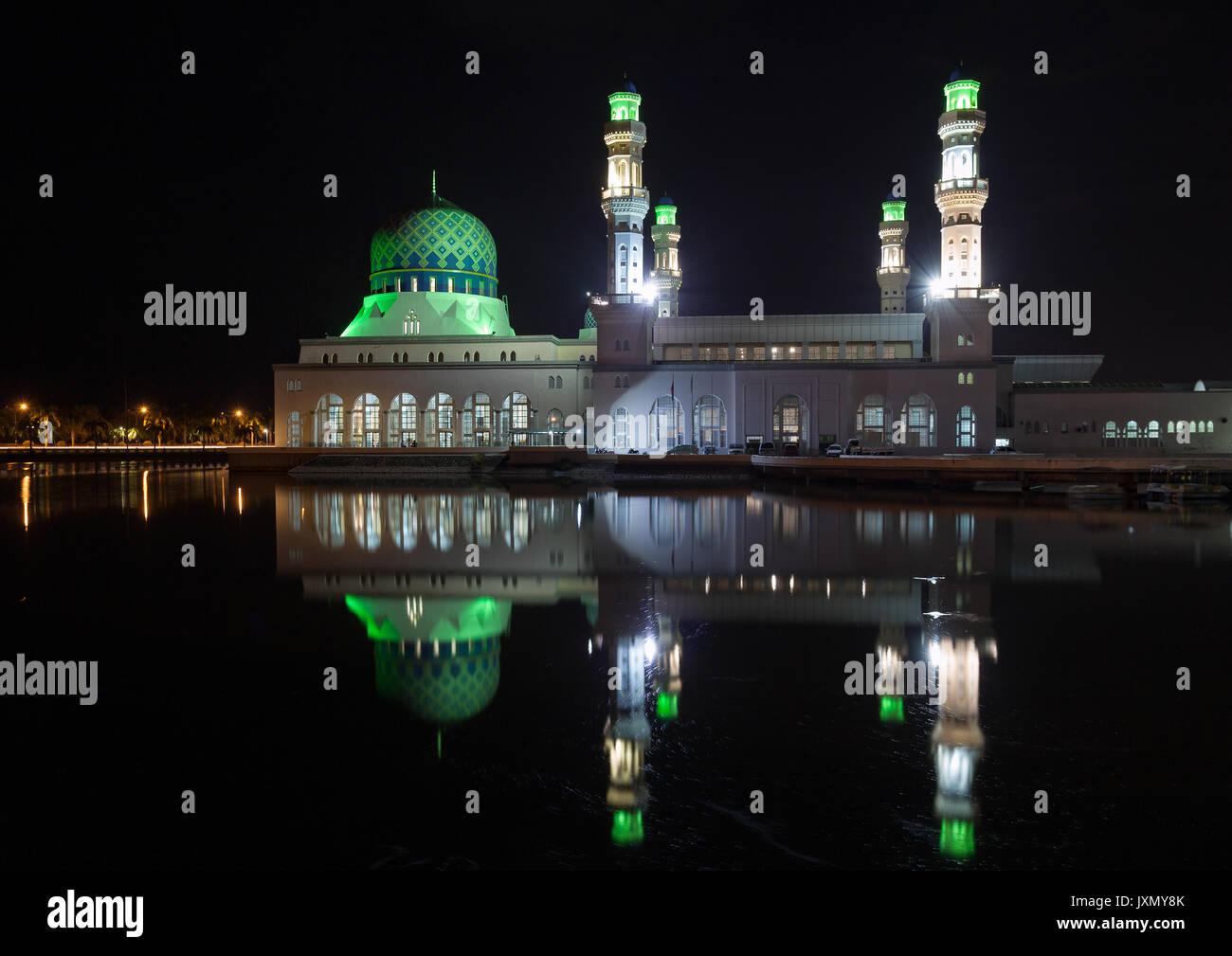 Kota Kinabalu city mosque by night, Sabah, Malaysia - Stock Image