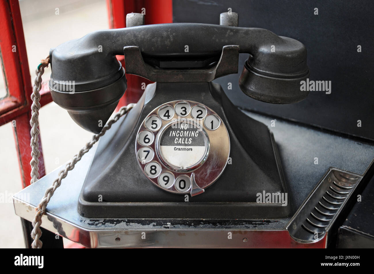 an old Bakelite telephone - Stock Image