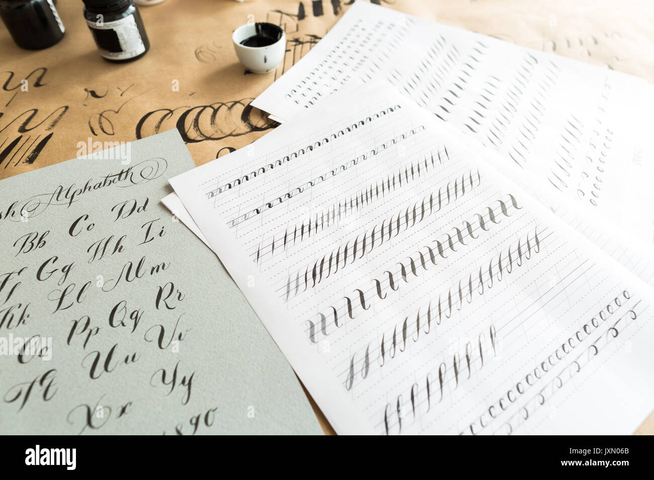 calligraphy, education, graphic design concept. lots of exercises for training skills of calligraphy with help of - Stock Image